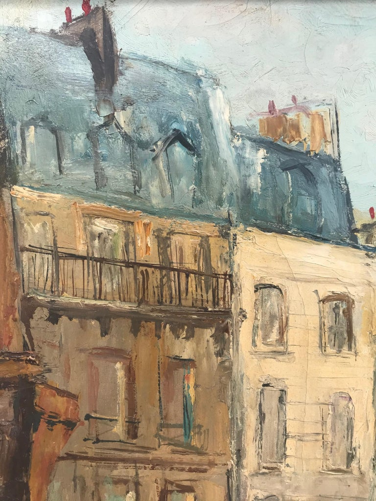 Parisian cityscape, signed and framed oil on canvas by Serge Belloni, '57  This painting has all the quintessential features of Belloni's renowned Parisian works. The street corner painted features the architecture of the Boucherie Chevaline,