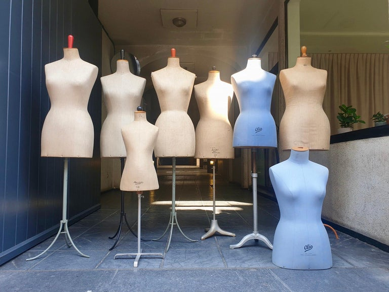 Eight old mannequins from France marked, Cléo and Belgium, Creme Lusenia Bruxelles with cast iron base.