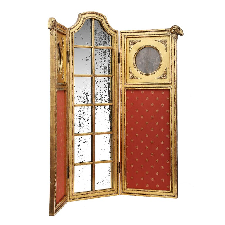 A charming and unusual scale French mid-19th century Louis XVI style three panel giltwood Parisian screen. The two outer upholstered panels are decorated with prints of the period framed with four little rosettes, all original mirrors.