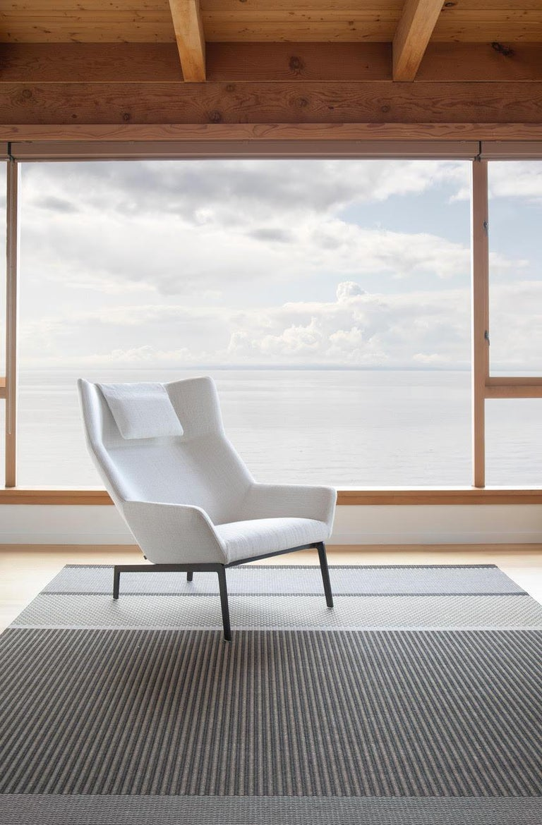 A contemporary wing-back chair. Park's sculptural lines and inviting seat create a beautiful statement in any room.