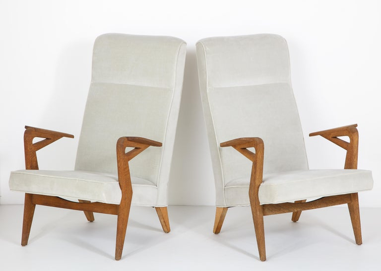 Parker-Knoll raw oak armchairs freshly reupholstered.