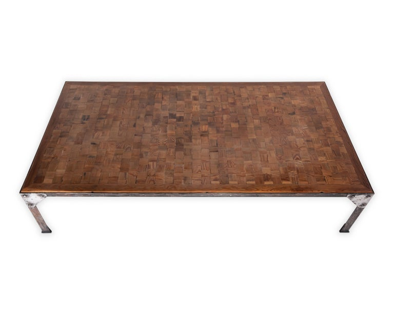 Parquetry top iron base coffee table.    Piece from the Le Monde collection. Exclusive to Brendan Bass.