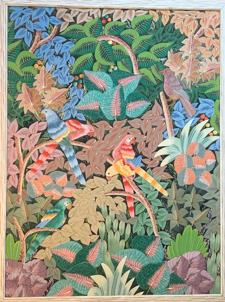 Exceptional oil painting on canvas by Haitian artist depicts lush green jungle with bright and vivid colorful parrots overlooking beautiful lush jungle, acrylic paint on canvas, with decorative bamboo like quality wood frame. Signed by the