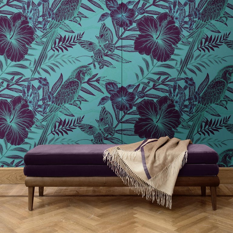 This elegant wall covering depicts a mesmerizing scene depicted as a negative photograph of an exotic scene with black parrots, hibiscus flowers, and butterflies over a green background. Part of the Parrots collection, this dramatic decoration will