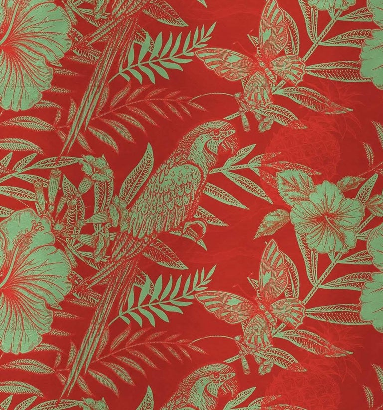 Elegant parrots, flying butterflies and blooming hibiscus flowers are stand out over a vivid red background in this dramatic and sophisticated wall covering. Making a statement in any room in the house, its silk and cotton surface can come as