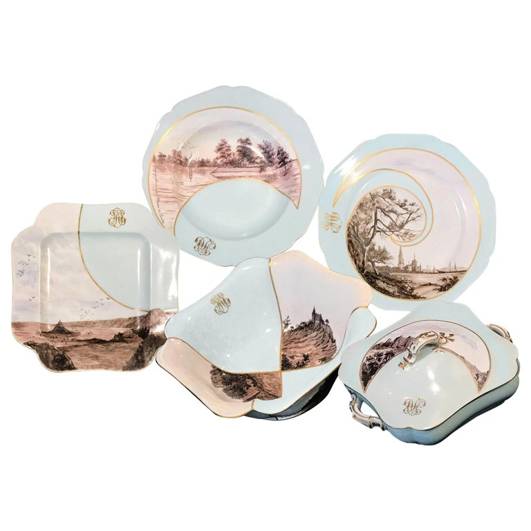 This unique and astonishing porcelain service was created and designed by Lucia Loché circa 1890 is composed of 40 pieces, end of the 19th century The decorations are hand-painted in blue background light pink, blue, and sepia tones on each piece by