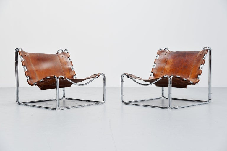 Ultra rare so called 'Fabio' lounge chair pair by Pascal Mourgue and manufactured by Sedia-Steiner, France 1970. This very nice low lounge chair pair is made of chrome plated tubular metal has an amazing shape! The nicely patinated natural leather