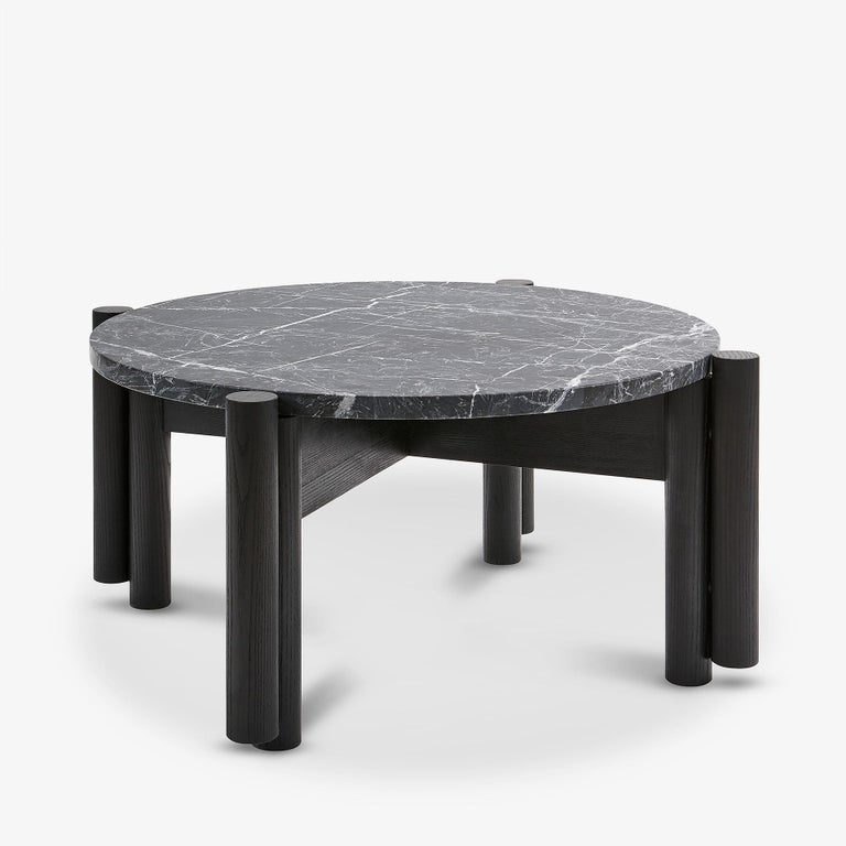 The Paso Fino coffee table by Danny Rosa has been designed exclusively for Studio 6F. Shown in Blackened Ash and Nero Marquina marble.   This piece is also completely customizable and can be made with an endless array of wood and stone options;