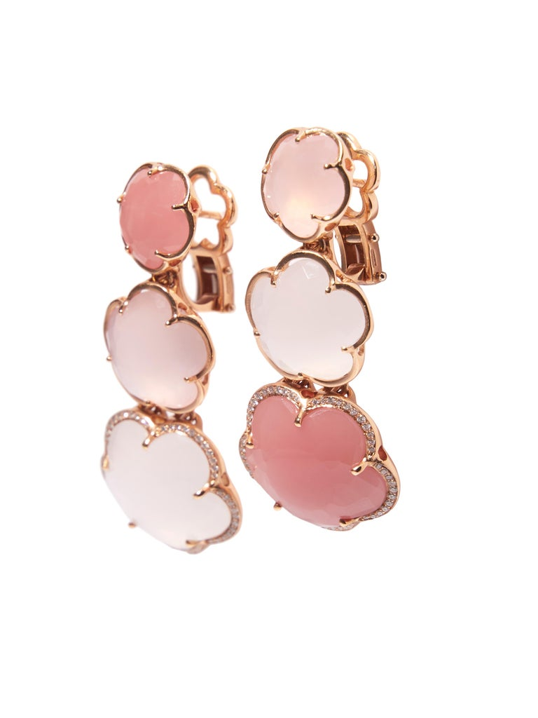 These 18 karat rose earrings with natural pink chalcedony, milky and pink quartz and diamonds are from the iconic Bon Ton Collection by Pasquale Bruni. The five-petal flower is the icon of Italian designer. The shimmering gemstones  Pink Chalcedony,