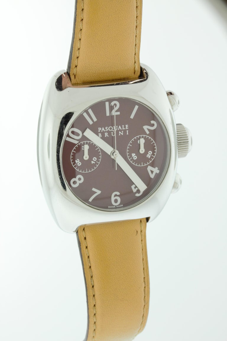This stainless steel watch features a brown face and a brown leather strap. Swiss made by Pasquale Bruni.  The front of the case is in great conditions with some minor scratches. the leather band and the back of the case has some age and use