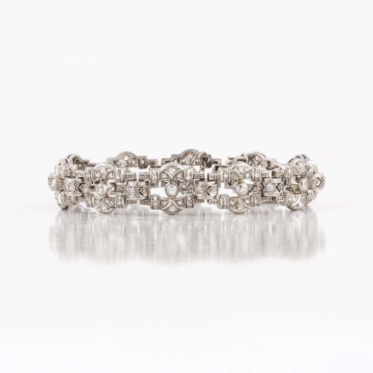 Art Deco platinum and diamond bracelet with geometric openwork links with pretty millegrain edges. Circa 1925.  Bracelet contains 80 rose-cut diamonds and 40 single-cut diamonds that total 1.90 carats, G-I color and SI1-2 clarity.  Measures 6 3/4