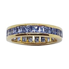 Pastel Blue Sapphire Eternity Ring Set in 18 Karat Gold Settings