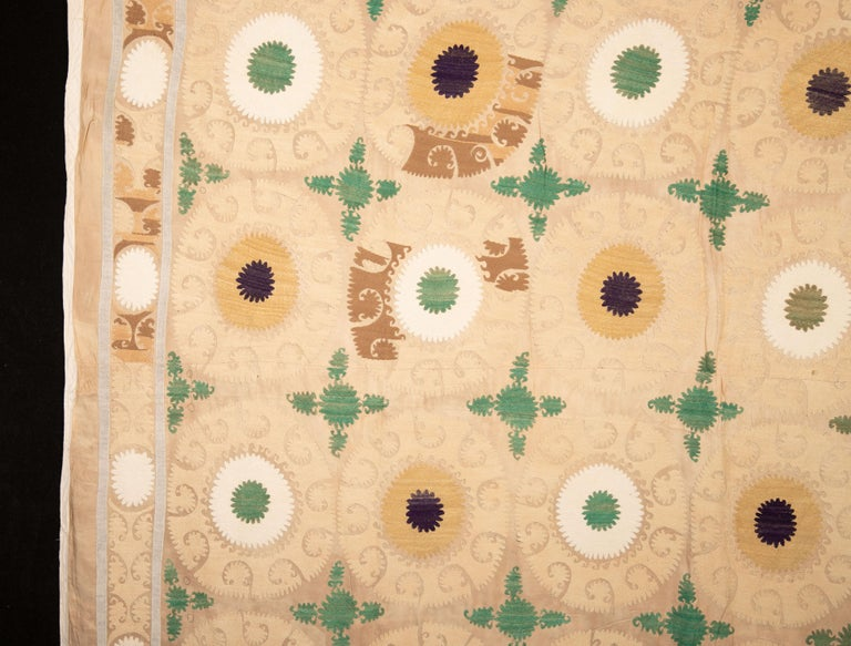 Suzani has soft colors with cotton embroidery on a rayon background.
