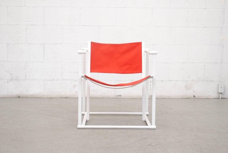 UMS Pastoe FM60, cubic chair lounge chair, designed in 1980 by Radboud Van Beekum. White Enameled steel frame with newly upholstered red/orange canvas seating. Frame is in original condition with slight wear to enamel.