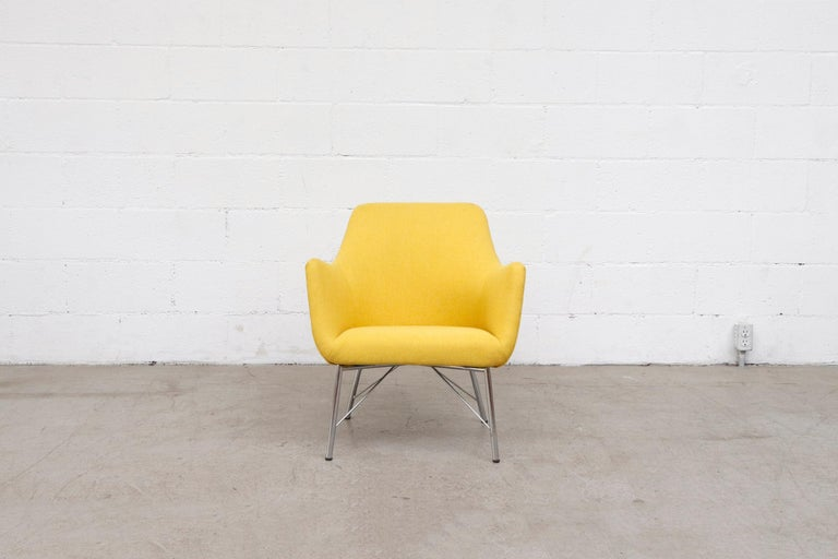 Newly re-upholstered in canary yellow fabric with original architectural chrome base. Frame is in original condition with signs of wear consistent with its age and use.