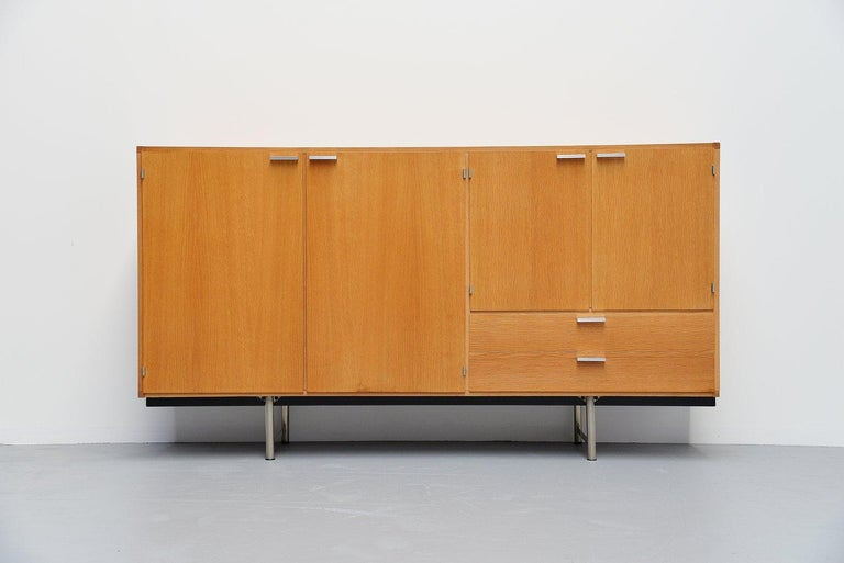 Fantastic grained buffet from the made to measure series designed by Cees Braakman for Pastoe, Holland, 1965. This oak veneered buffet has a nice and warm color wood. It has solid aluminium handles and a chrome plated metal base. This buffet
