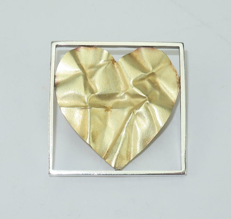 The crumpled heart tells a story as Pat Flynn, New York goldsmith, intended with his iconic contemporary design.  Mr. Flynn's hearts have been a constant in his repertoire of modernist jewelry and this sterling silver and 18K gold 'crumpled' heart