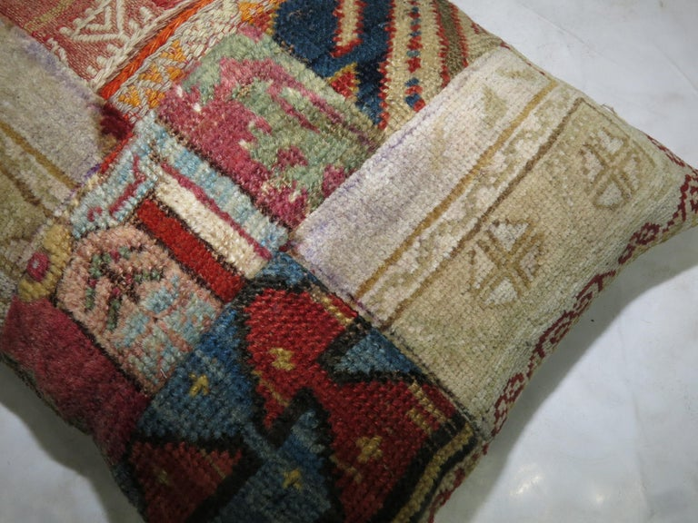 Pillow made from an assortment of antique Persian and tribal Caucasian rugs.