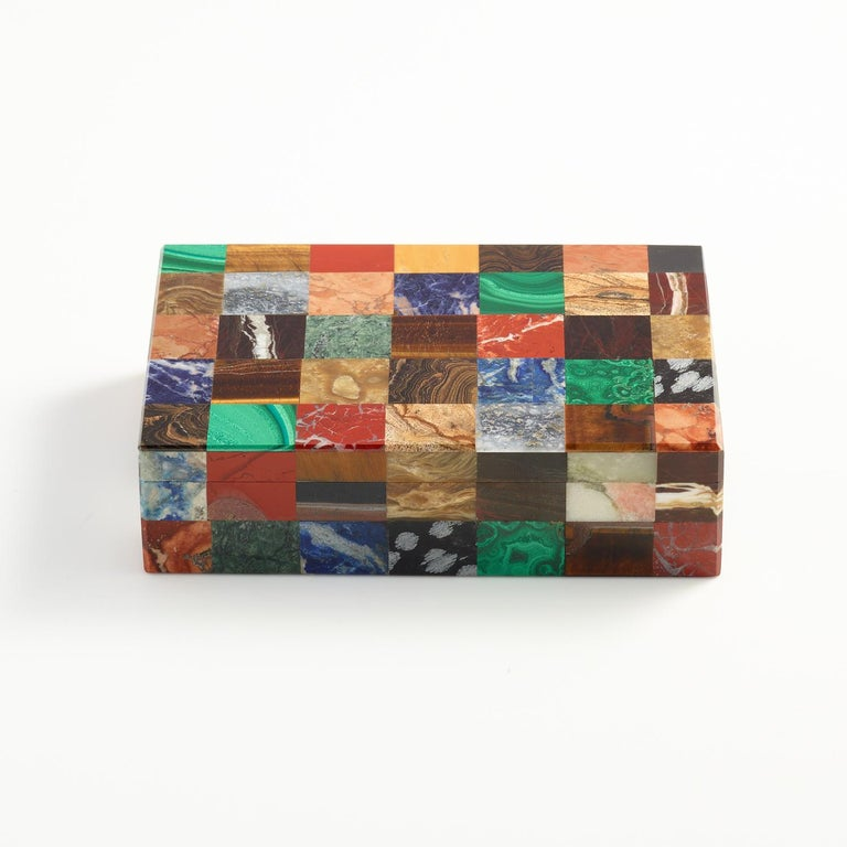 A colorful patchwork stone specimen box, Italian, circa 1930.  Excellent quality both on the exterior and interior which is lined with black onyx and as can be seen the exterior stones samples are beautifully matched.   This box works will