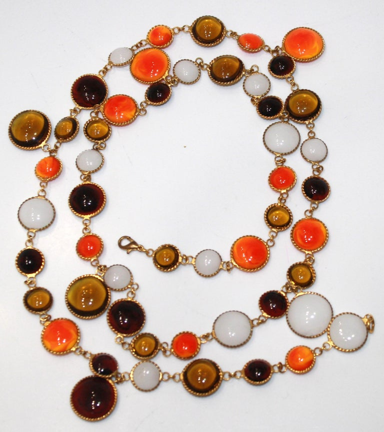 Orange, alabaster, honey colored pate de verre handmade by former artisans of the house of Gripoix. Unique color combination for Isabelle k Jewelry