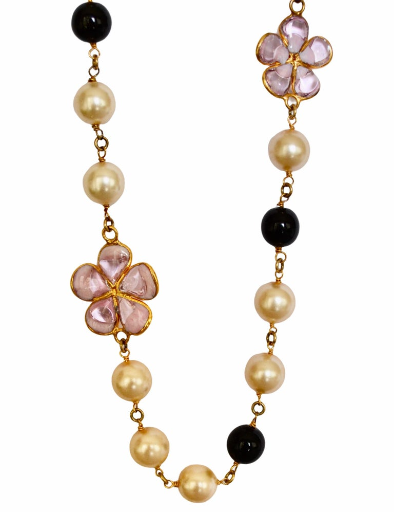 Handmade glass pearls and clover leaf motif made in different colors to pate de verre or glass paste. Gripoix work