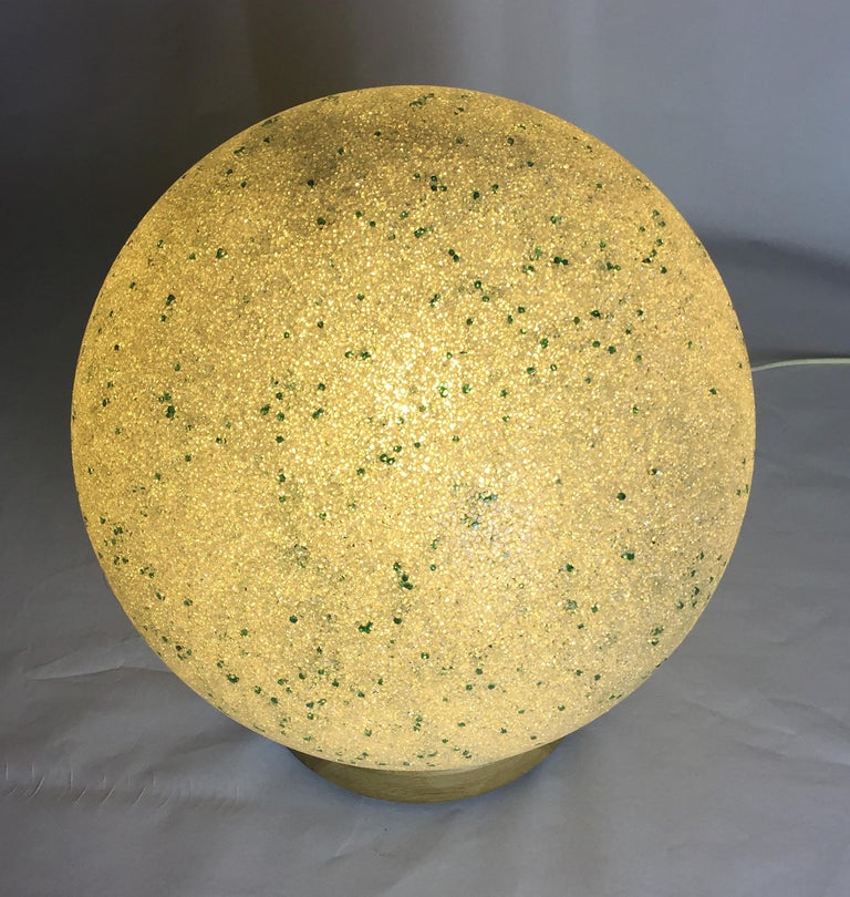 Delicate pâte de verre lamp with green inclusions. Made in Murano in 1960. Originally a pendant light, now mounted on a turned oak base with lamp holder.  The process of making Pate d'Verre is by pushing glass beads into a mould and then fusing