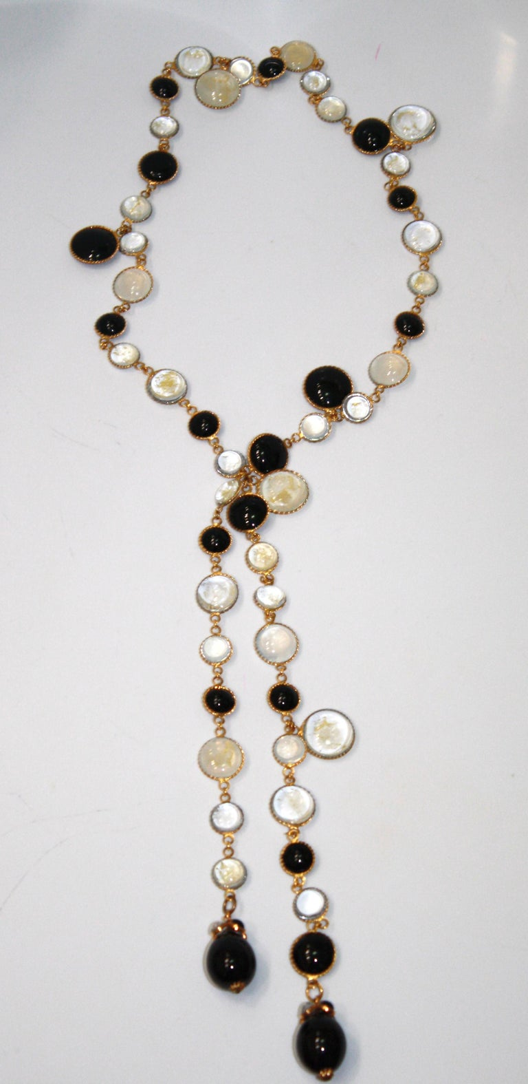Poured glass in black, alabaster, clear,  gold leaf is inserted in the glass . Uniquely  made for Isabelle K Jewelry.. Process of pate de verre made by the former artisans of the former atelier of Gripoix.