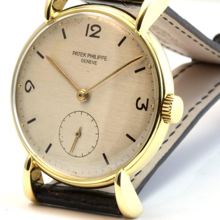 This 1543J vintage Patek Philippe watch features large lugs, sub-second dial, new Patek alligator strap.  The watch was made  in 1947.  The watch comes with a 1 year movement guarantee and an   - Watch Specifications - - Reference Number: 1543J -