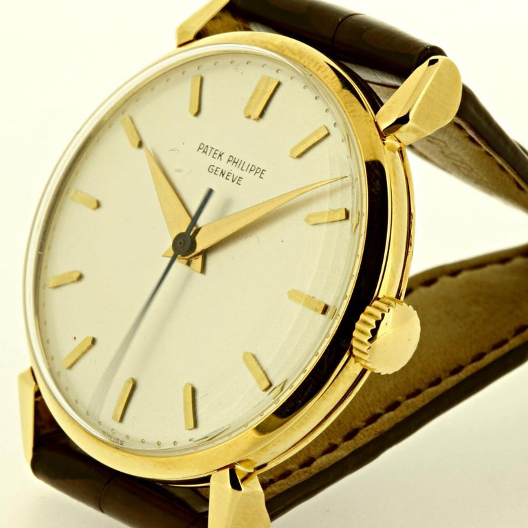 This 1578J Patek Philippe Calatrava watch features a 35 mm in diameter case, with a white dial, sweep second hand and tear drop lugs.    The watch was made in 1955  The watch comes with a 27 SC caliber movement # 704005, case # 685656.  The watch
