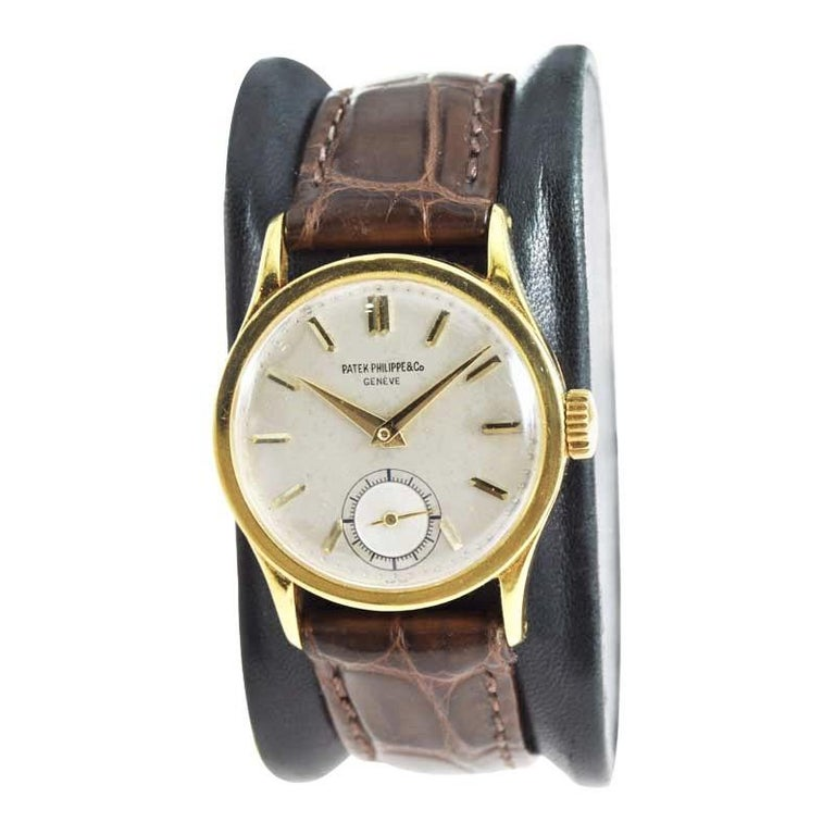FACTORY / HOUSE: Patek Philippe et Cie. STYLE / REFERENCE: Round Calatrava / Ref. 96 METAL / MATERIAL: 18 Karat Yellow Gold CIRCA / YEAR: 1940's DIMENSIONS / SIZE: 38 mm X 31 mm MOVEMENT / CALIBER: Manual Winding / 18 Jewels DIAL / HANDS: Original