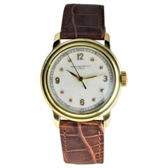 Patek Philippe 18 Karat Gold Watch with a Custom Case and Archival Document