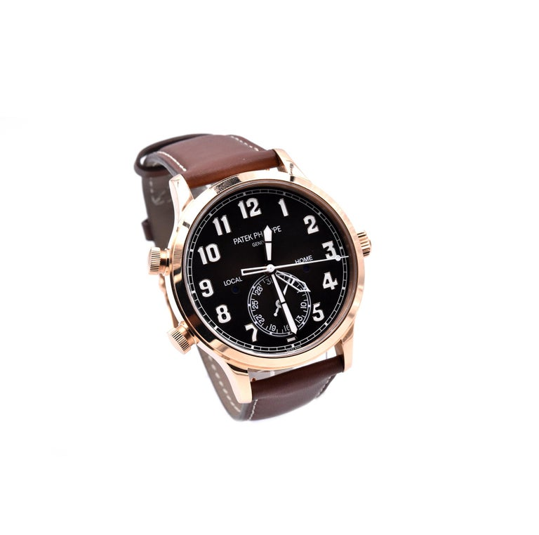 Movement: automatic Function: hours, minuet, seconds, date, GMT Case: 42mm 18K rose gold round case, sapphire crystal, rotating crown Dial: blbrown sunburst, black gradated, gold applied numerals with luminescent coating Band: Patek Philippe
