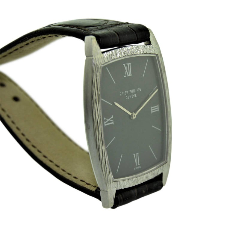 Patek Philippe 18 Karat White Gold Tonneau Shape Wristwatch with Carved Bezel In Excellent Condition For Sale In Long Beach, CA