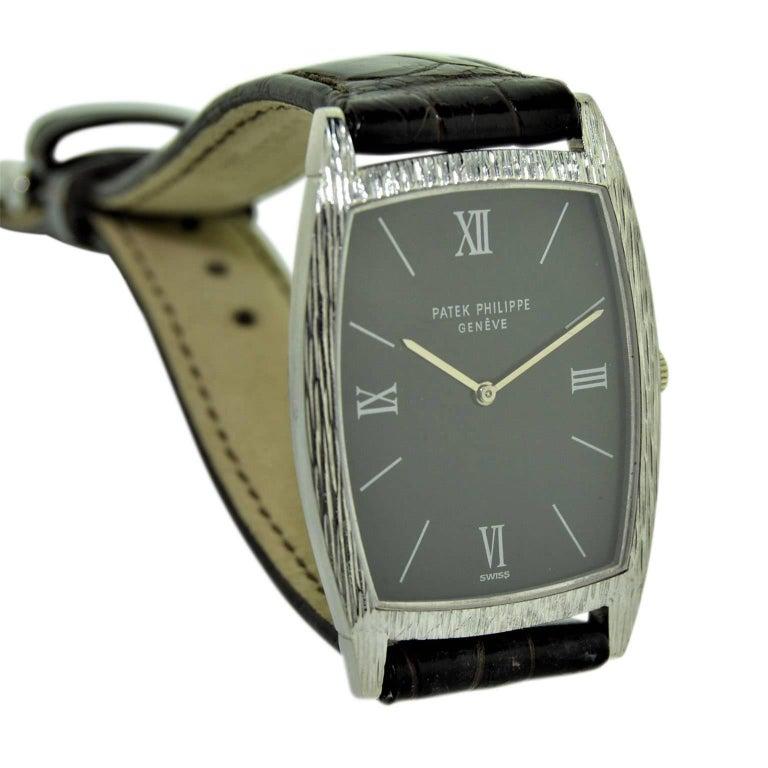 Women's or Men's Patek Philippe 18 Karat White Gold Tonneau Shape Wristwatch with Carved Bezel For Sale