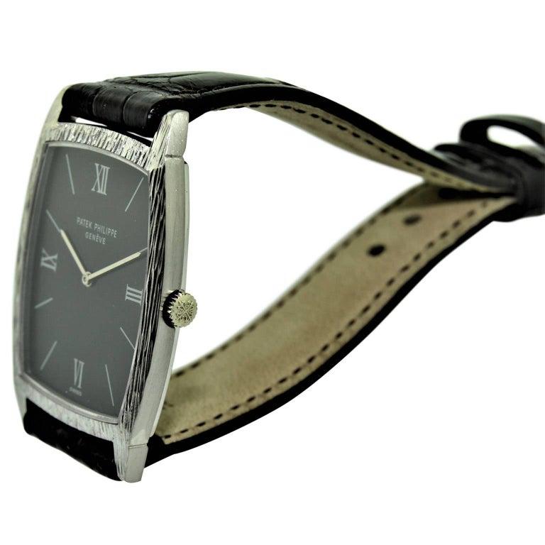 Patek Philippe 18 Karat White Gold Tonneau Shape Wristwatch with Carved Bezel For Sale 1