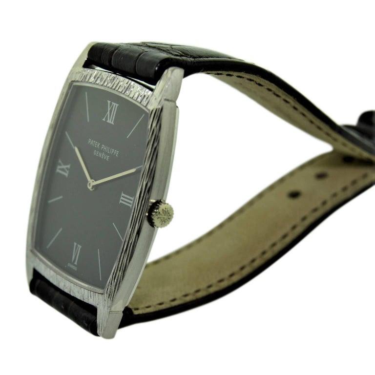 Patek Philippe 18 Karat White Gold Tonneau Shape Wristwatch with Carved Bezel For Sale 3