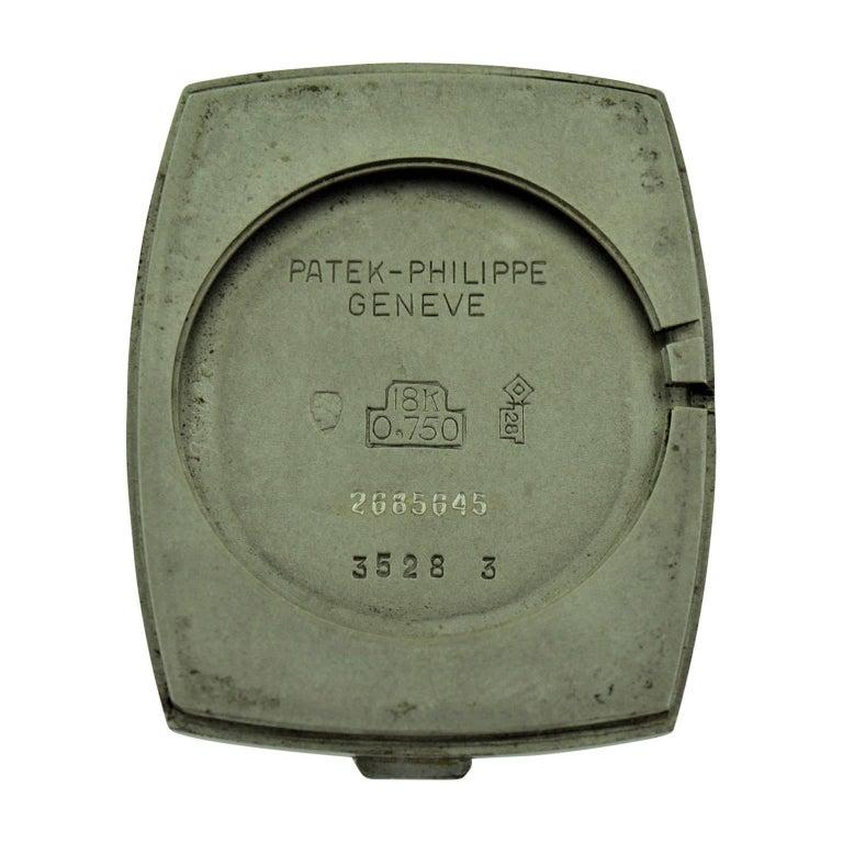Patek Philippe 18 Karat White Gold Tonneau Shape Wristwatch with Carved Bezel For Sale 5