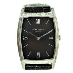 Patek Philippe 18 Karat White Gold Tonneau Shape Wristwatch with Carved Bezel