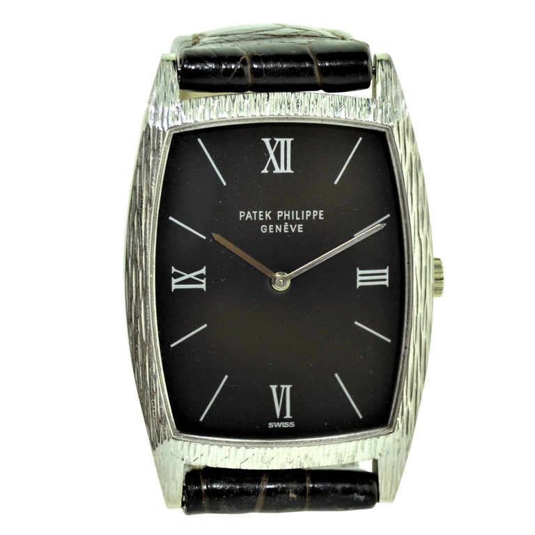 Patek Philippe 18 Karat White Gold Tonneau Shape Wristwatch with Carved Bezel For Sale