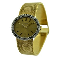 Patek Philippe 18 Karat Yellow Gold Ladies Dress Watch with Diamond Bezel