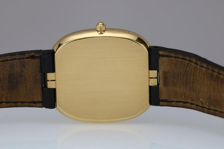Patek Philippe Ellipse Ref 3738 with a slate blue dial, 18k yellow gold hidden lug case has a black Patek Philippe leather strap and 18k tang buckle.