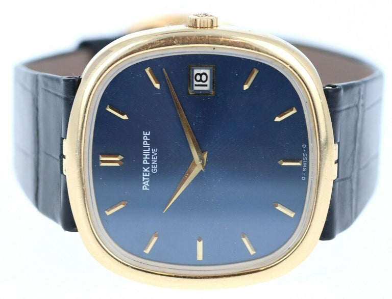 Patek Philippe 18k Yellow Gold Jumbo Ellipse 3605 Blue Dial   Brand	Patek Philippe Ref #	3605 Dial.         Blue Case Material	18k yellow gold Case Size	36mm Bracelet	       Black strap Movement	Automatic Papers	No
