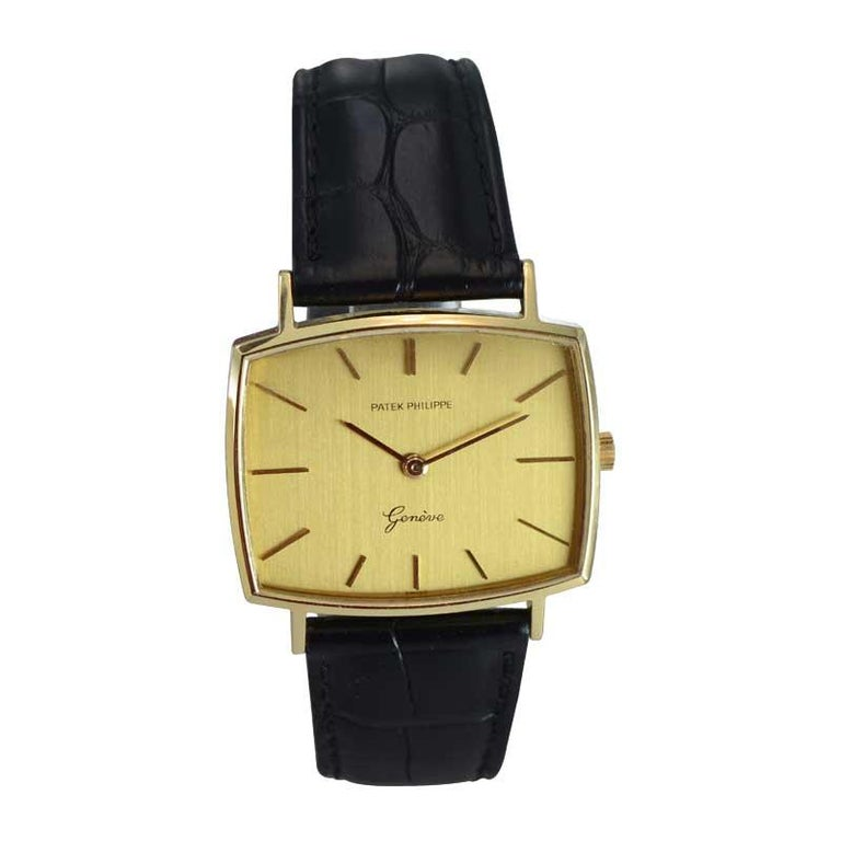 FACTORY / HOUSE: Patek Philippe & Cie. STYLE / REFERENCE: Cushion Shape / REf. 3527 METAL / MATERIAL: 18kt Yellow Gold CIRCA / YEAR: 1960's DIMENSIONS / SIZE: 33mm x 34mm MOVEMENT / CALIBER: Manual Winding / 18 Jewels / Cal. 3527 DIAL / HANDS: