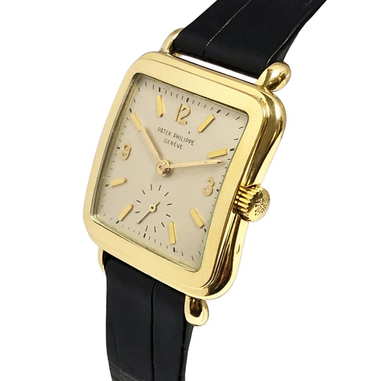 Circa 1950s Patek Philippe Reference 2493 Wrist watch, 39 X 30 18K yellow Gold 2 Piece Stepped case with tear Drop lugs, 18 Jewel caliber 10-200 Mechanical, Manual wind nickle lever movement. Original Silver satin dial with raised Gold markers and a
