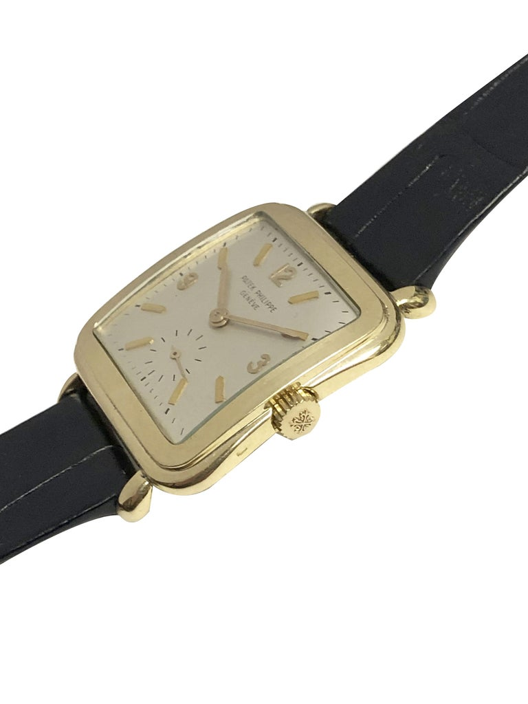 Patek Philippe 1950s Ref 2493 Large Yellow Gold Mechanical Wristwatch In Excellent Condition For Sale In Chicago, IL