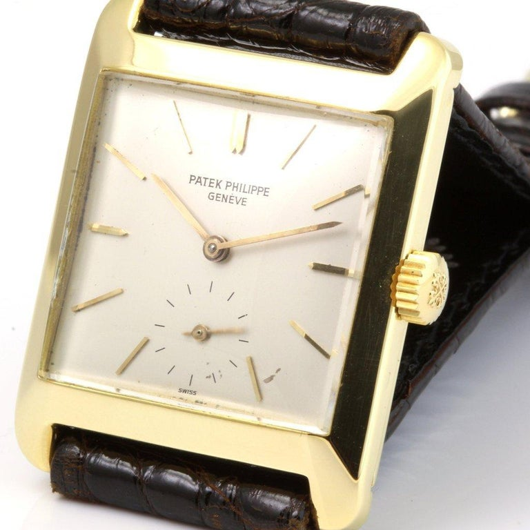 This 2488J vintage rectangular Patek Philippe watch features sub-seconds dial, new Patek alligator strap with original 18K yellow gold Patek buckle.  This watch was made in 1954.  The watch comes with a 1 year movement guarantee and an extract from