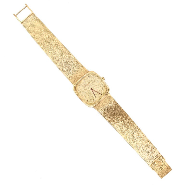 Beautiful wristwatch:  PATEK PHILIPPE slim cushion wristwatch with integral mesh bracelet.  18K textured yellow gold.  Softened edge square case, approximately 28mm x 28mm.  7