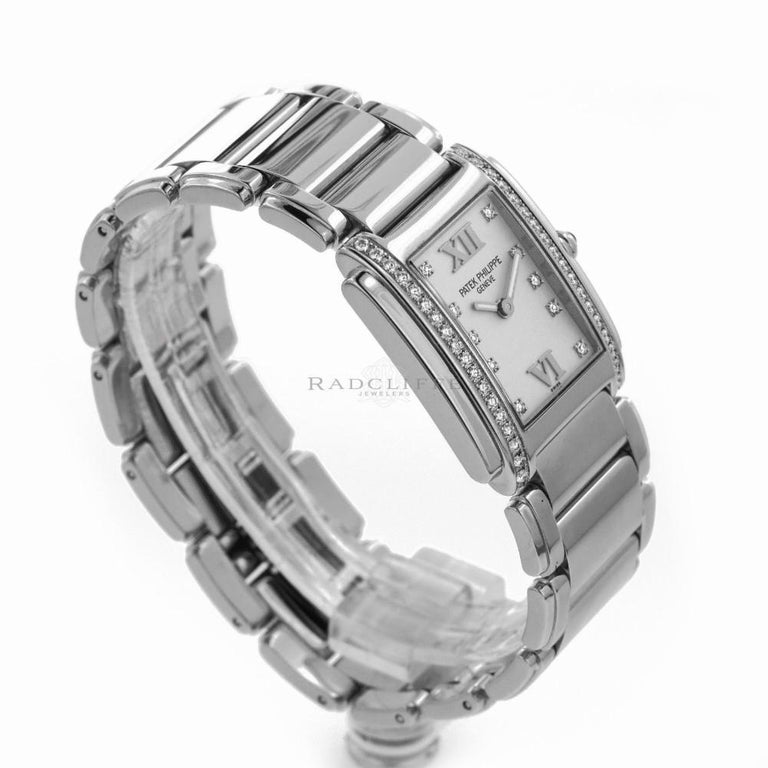 Patek Philippe Twenty 4 Reference #:4910/10A-011. Women's  stainless steel, Patek Philippe, Twenty 4  4910/10A-011, swiss quartz. Verified and Certified by WatchFacts. 1 year warranty offered by WatchFacts.