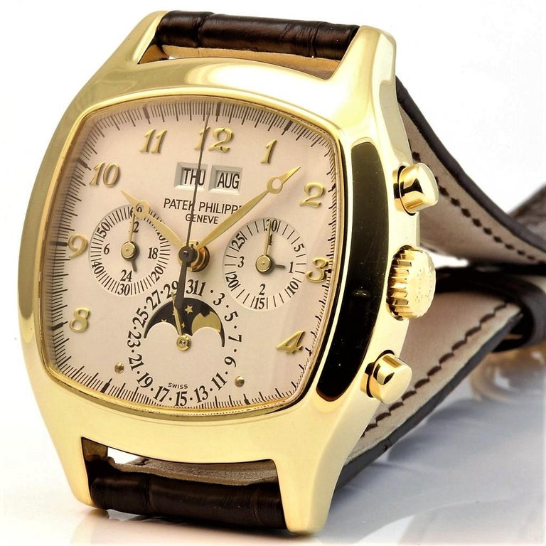 This 5020J Patek Philippe watch features a manual wind movement that features:  Perpetual calendar,  Chronograph,  Moon phase Day, Date and Month Indicators. This example has not been published and is a very