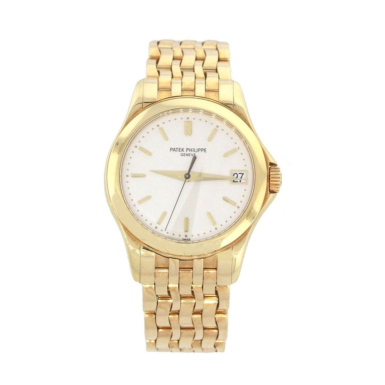 Brand: Patek Philippe MPN: 5107J Model: Calatrava Material: 18k Yellow Gold Dial: White Dial with gold hands and stick markers, date can be found at 3 O'Clock. Bezel: Smooth 18k yellow gold bezel Case Measurements: 37mm Bracelet: 18k Yellow gold